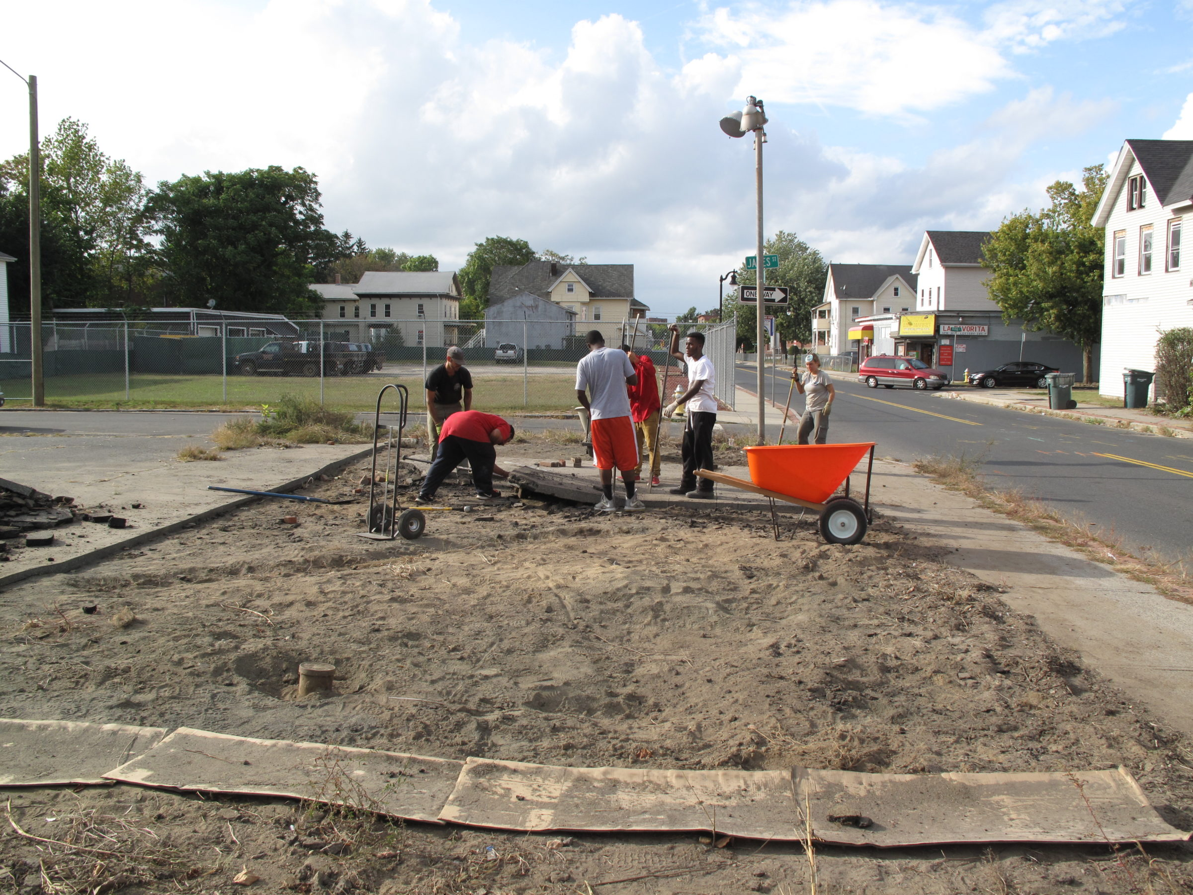 Preparing the site by removing the blacktop, shaping the garden, adding compost and soil amendments.