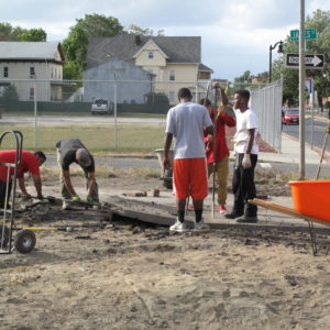 Removing Concrete And Installing A Rain Garden At The Gardening The Community Urban Farm.