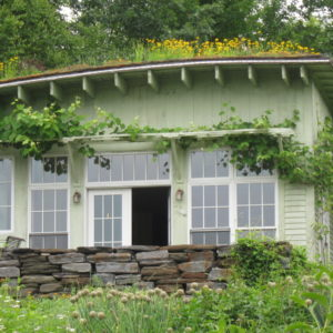 An Innovative Green Roof Provides Additional Seasonal Color And Windows Are Shielded From Summer Sun By A Grape Arbor.